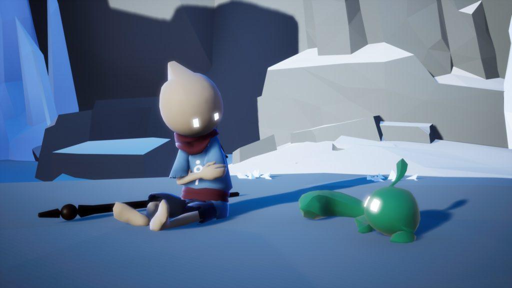 Screenshot aus Omno. Links sitzt die Hauptfigur und schaut nach rechts auf ein kleines, auf dem Boden liegendes, grünes Wesen. Deren Blicke treffen sich. Im Hintergrund eine Felswand.